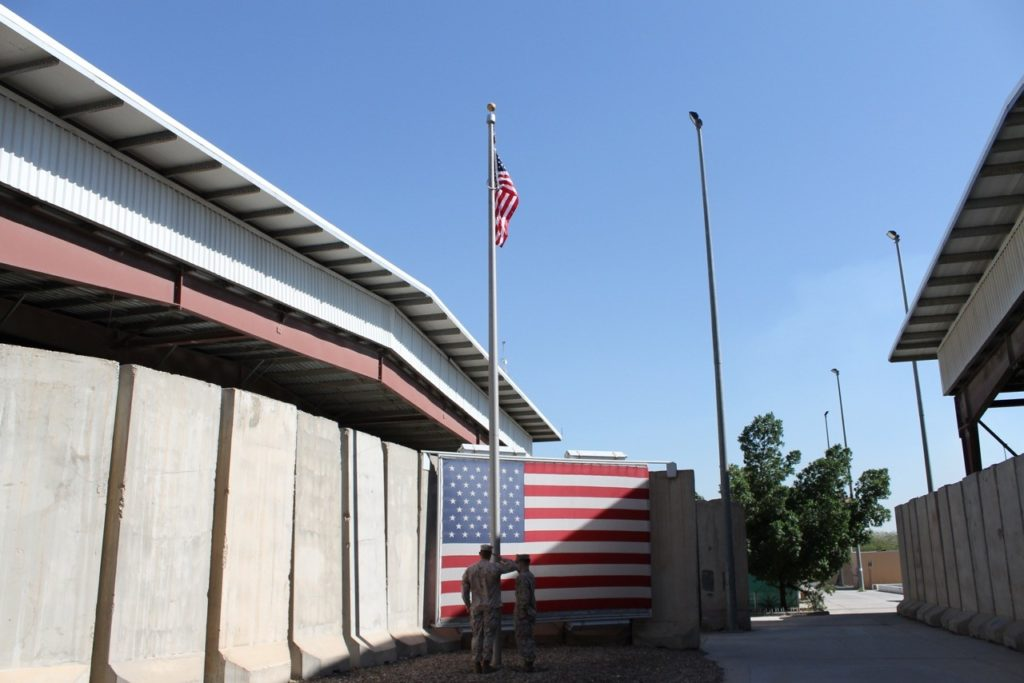 Marines raising the flag in Baghdad, Iraq, where Jim was deployed in 2011