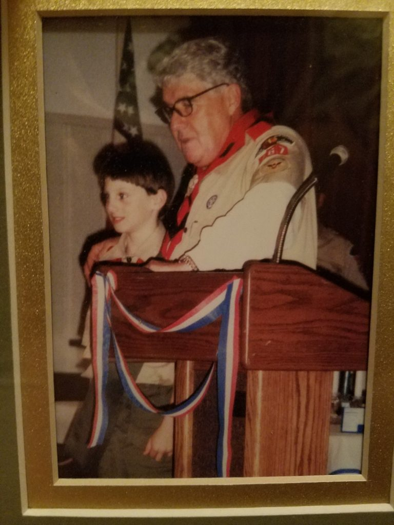 A much younger Danny receiving an award from his Scoutmaster, Mark Dunaway