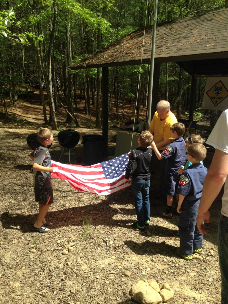 Pack 417 lowers the flag.