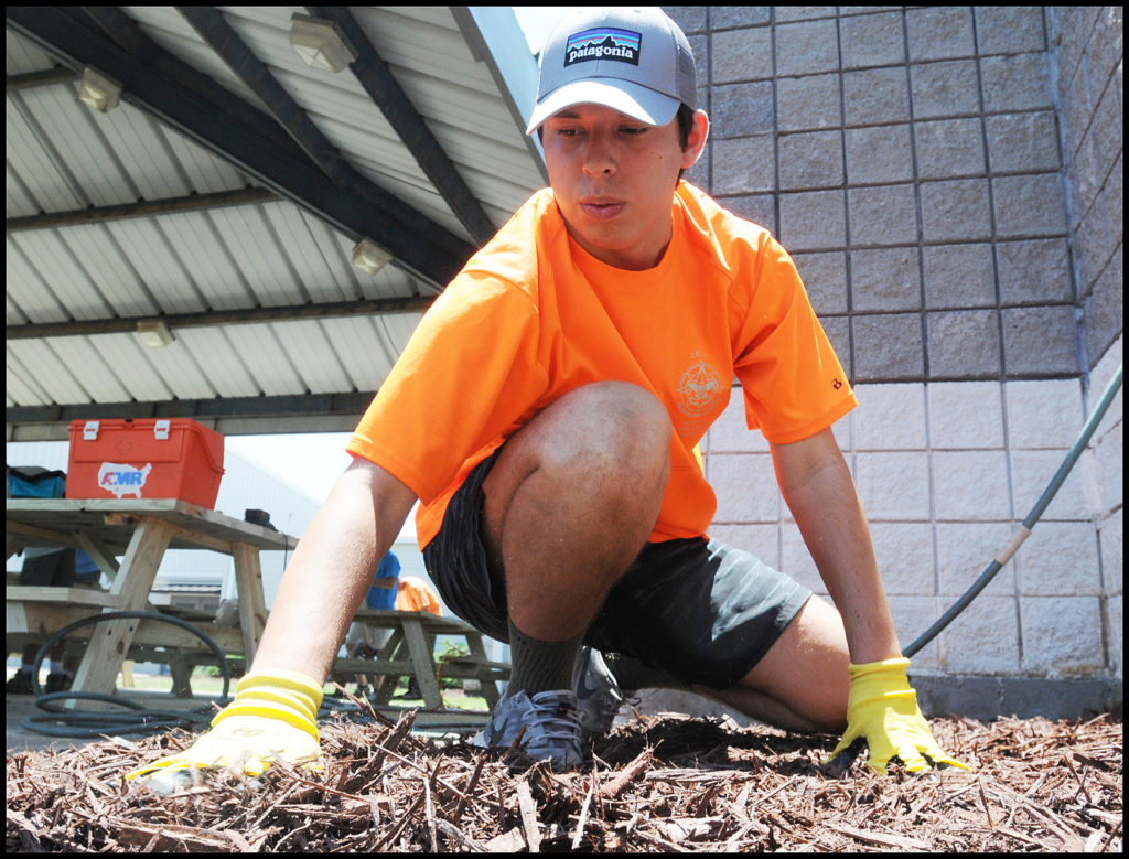 Jackson spreads mulch during his Eagle Project