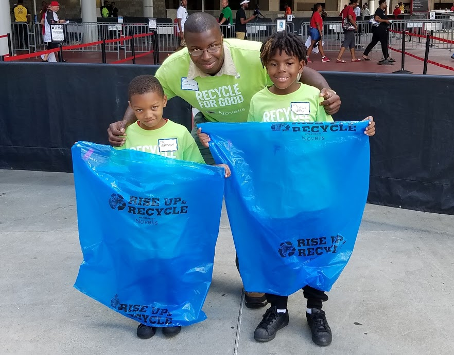 Cub Scouts recycle cans at the Falcons Game