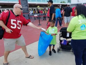 A Falcons fan recycles a can