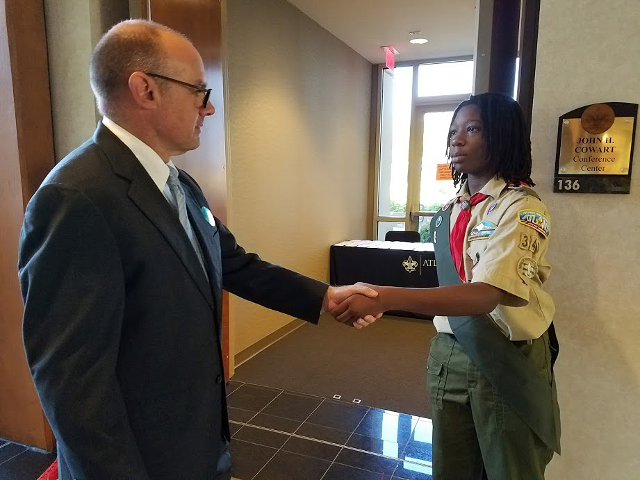 Scouts greet board members