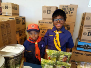 Scouts show off their wares during the Board of Directors Meeting