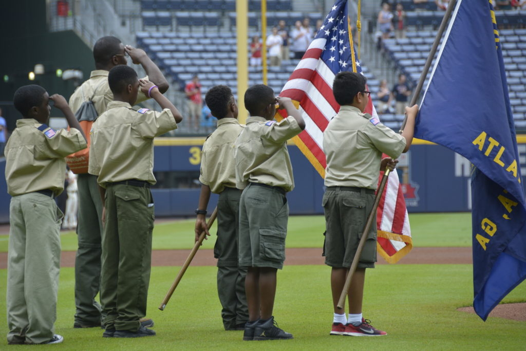Scouts lead Turner Field in the National Anthem