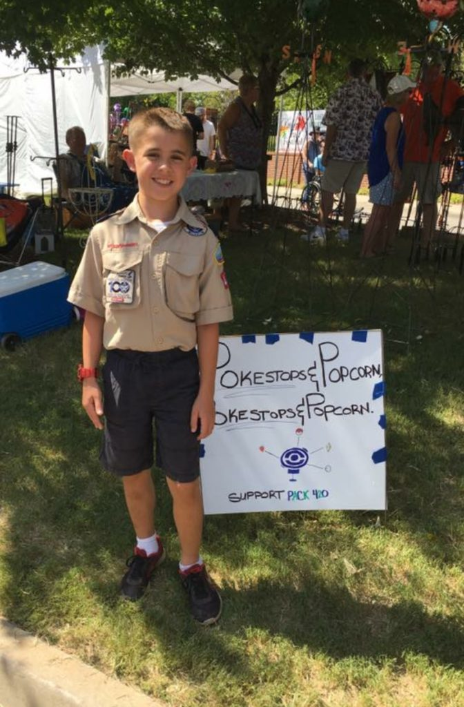 Star Scout Joseph stands with one of his signs