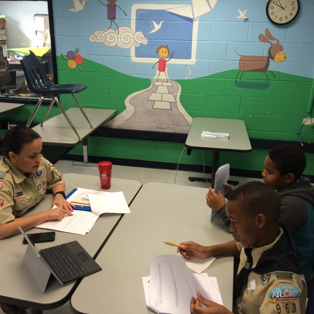 Scouts work on the Citizenship in the Nation Merit Badge