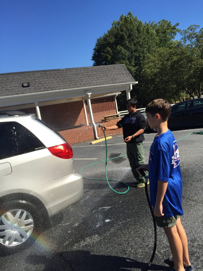 Scouts from Troop 69 wash cars