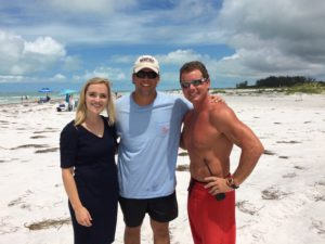 Clay Buchewitz with a reporter and the lifeguard who aided in the rescue