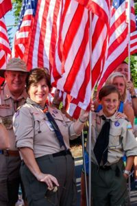 Scouts march with Flags