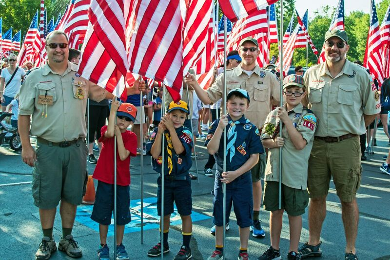 Scouts march to the Field of Flags Memorial Site