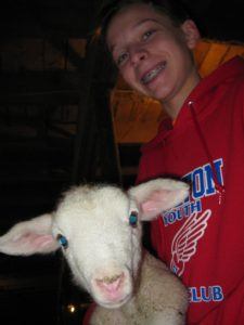 Holding 4 day old baby lamb while earning Animal Science Merit Badge