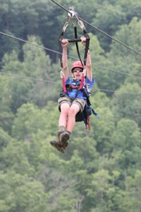 Zipping down the ¾ mile zip line at Summit High Adventure