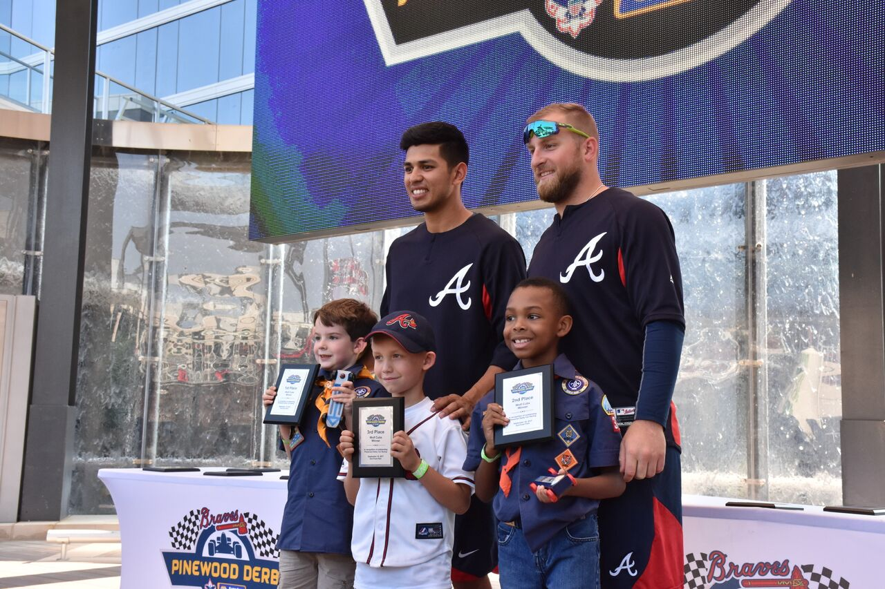 Three Cub Scouts pose with Atlanta Braves players Ruiz and Krol