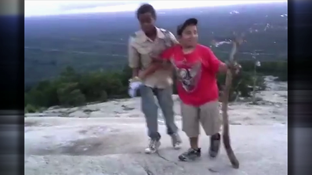 Tion helps Jesus up Stone Mountain