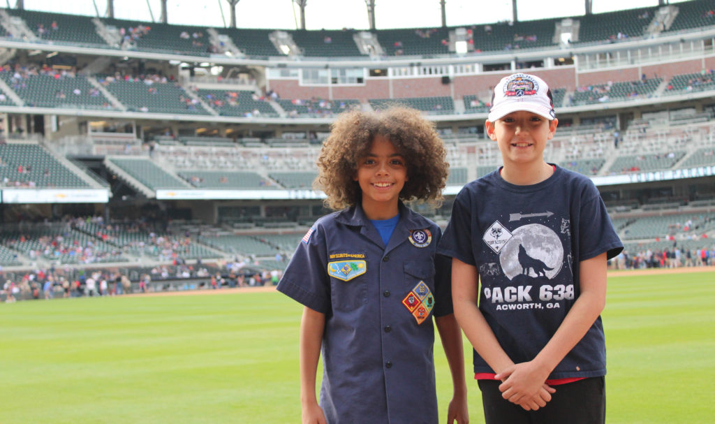 Two Scouts on the field at SunTrust Park for Scout Day with the Braves