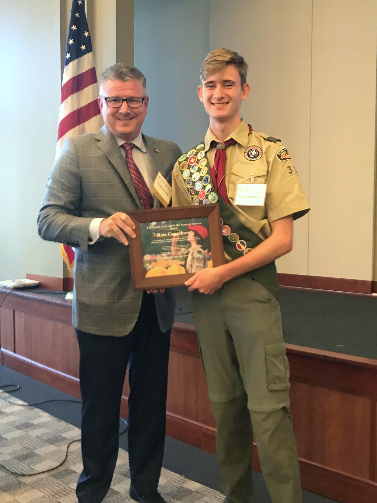 Eagle Scout Ross Copenhaver is honored at an Atlanta Area Council Board of Directors Meeting